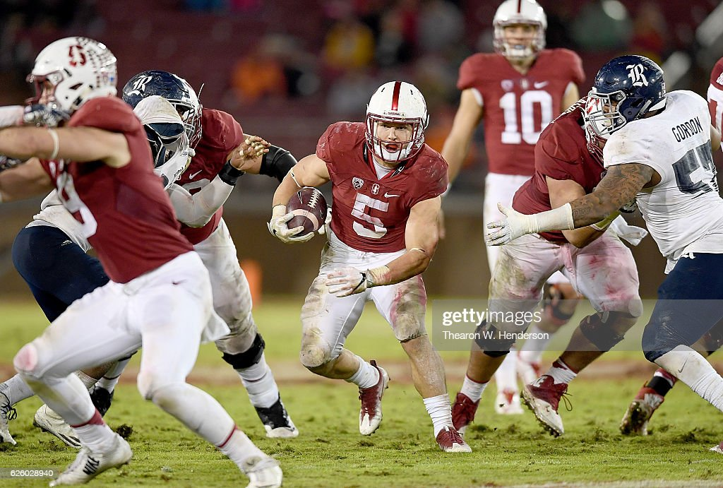 Christian McCaffrey #5 of the Stanford Cardinal carries the ball against the Rice Owls in the third quarter of their NCAA football game at Stanford Stadium on November 26, 2016 in Palo Alto, California.