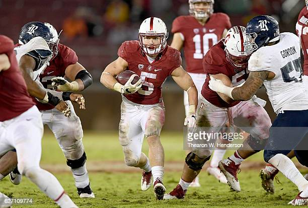 Christian McCaffrey of the Stanford Cardinal carries the ball against the Rice Owls in the third quarter of their NCAA football game at Stanford...