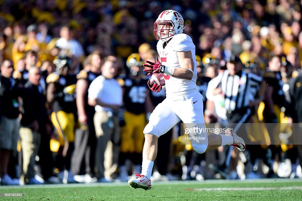 Christian McCaffrey of the Stanford Cardinal catches a 75 yard touchdown pass on the first play of the game against the Iowa Hawkeyes in the 102nd...