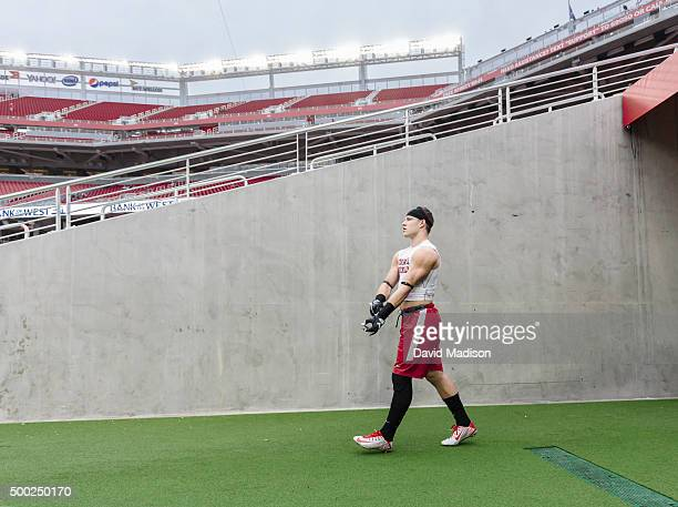 Christian McCaffrey of the Stanford Cardinal enters the field for warmups prior to the Pac12 Championship Game against the USC Trojans played on...