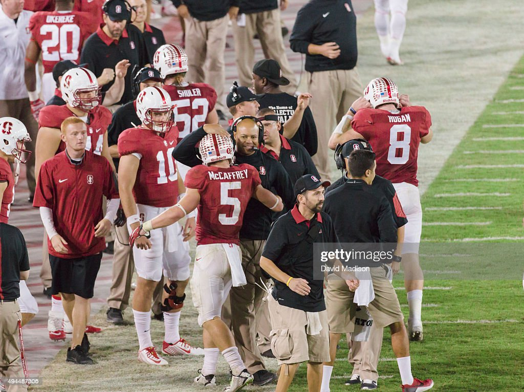 <a gi-track='captionPersonalityLinkClicked' href=/galleries/search?phrase=Christian+McCaffrey&family=editorial&specificpeople=10229486 ng-click='$event.stopPropagation()'>Christian McCaffrey</a> #5 of the Stanford Cardinal is congratulated by head coach <a gi-track='captionPersonalityLinkClicked' href=/galleries/search?phrase=David+Shaw+-+Amerikaans+football+coach&family=editorial&specificpeople=8769878 ng-click='$event.stopPropagation()'>David Shaw</a> after scoring a touchdown during a PAC-12 football game against the University of Washington Huskies played on October 24, 2015 at Stanford Stadium on the campus of Stanford University in Palo Alto, California. Other visible players include #10 Keller Chryst and #8 Kevin Hogan.