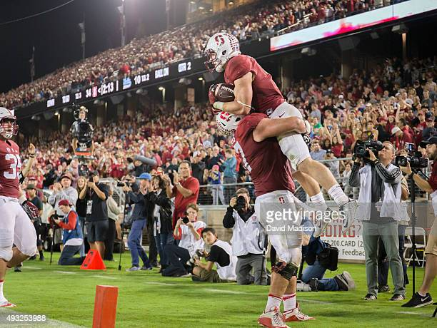 Christian McCaffrey of the Stanford Cardinal is lifted by teammate Johnny Caspers while celebrating a touchdown run during a PAC12 football game...