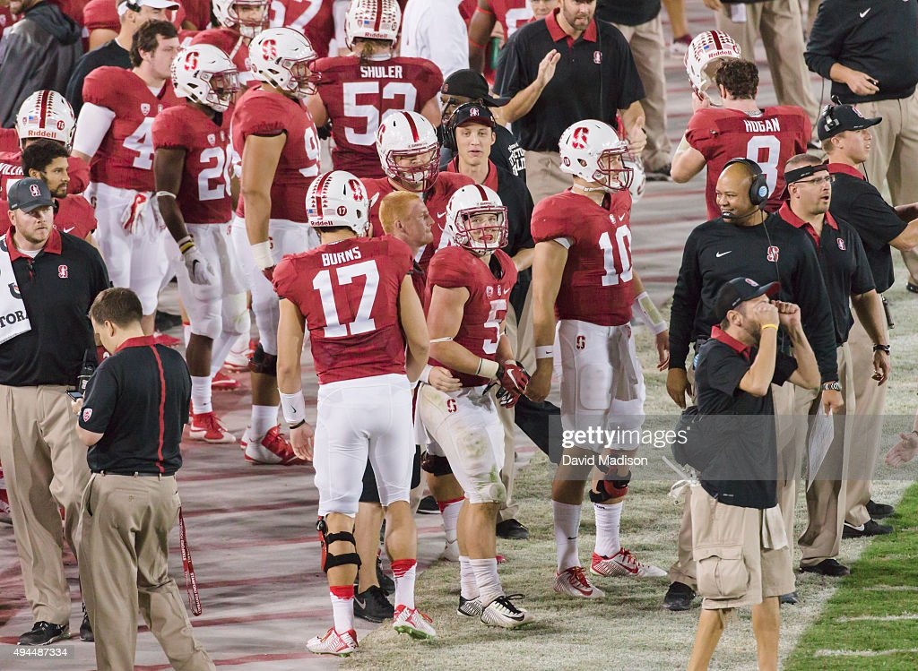 <a gi-track='captionPersonalityLinkClicked' href=/galleries/search?phrase=Christian+McCaffrey&family=editorial&specificpeople=10229486 ng-click='$event.stopPropagation()'>Christian McCaffrey</a> #5 of the Stanford Cardinal looks at the scoreboard replay after scoring a touchdown during a PAC-12 football game against the University of Washington Huskies played on October 24, 2015 at Stanford Stadium on the campus of Stanford University in Palo Alto, California. Head Coach <a gi-track='captionPersonalityLinkClicked' href=/galleries/search?phrase=David+Shaw+-+Amerikaans+football+coach&family=editorial&specificpeople=8769878 ng-click='$event.stopPropagation()'>David Shaw</a> is visible at right.