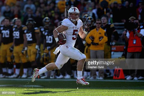 Christian McCaffrey of the Stanford Cardinal returns a punt 63 yards for a touchdown in the second quarter agains the Iowa Hawkeyes in the 102nd Rose...