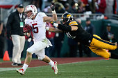 Christian McCaffrey of the Stanford Cardinal runs away from the defense of Bo Bower of the Iowa Hawkeyes in the 102nd Rose Bowl Game on January 1...