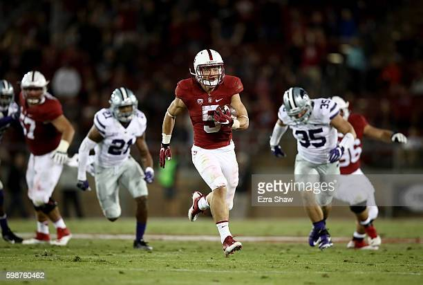 Christian McCaffrey of the Stanford Cardinal runs in for a touchdown against the Kansas State Wildcats at Stanford Stadium on September 2 2016 in...