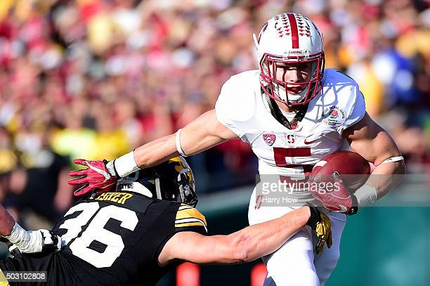 Christian McCaffrey of the Stanford Cardinal runs past Cole Fisher of the Iowa Hawkeyes in the 102nd Rose Bowl Game on January 1 2016 at the Rose...