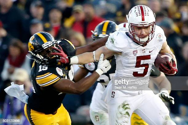 Christian McCaffrey of the Stanford Cardinal runs past Joshua Jackson of the Iowa Hawkeyes in the second half of the 102nd Rose Bowl Game on January...