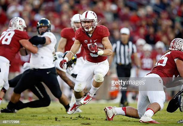 Christian McCaffrey of the Stanford Cardinal runs with the ball against the Oregon Ducks at Stanford Stadium on November 14 2015 in Palo Alto...