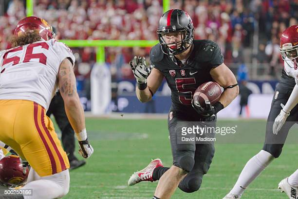 Christian McCaffrey of the Stanford Cardinal runs with the ball during the Pac12 Championship Game against the USC Trojans played on December 5 2015...