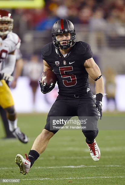 Christian McCaffrey of the Stanford Cardinal rushes with the ball against the USC Trojans during the first quarter of the NCAA Pac12 Championship...