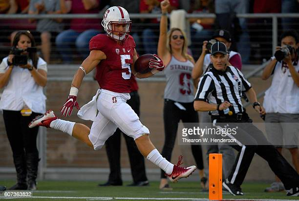 Christian McCaffrey of the Stanford Cardinal scores a touchdown against the USC Trojans in the first half of their NCAA football game at Stanford...