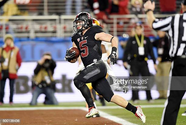 Christian McCaffrey of the Stanford Cardinal scores the first of two touchdowns against the USC Trojans in the fourth quarter of the NCAA Pac12...