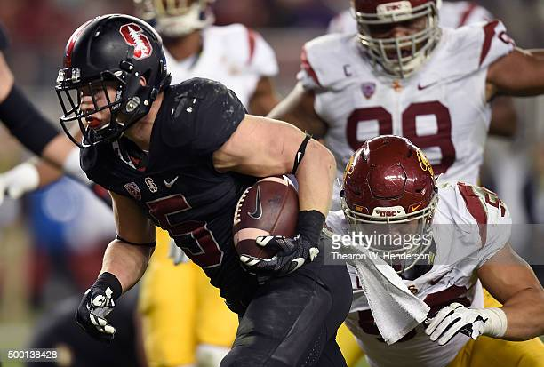 Christian McCaffrey of the Stanford Cardinal scores the second of two touchdowns against the USC Trojans in the fourth quarter of the NCAA Pac12...
