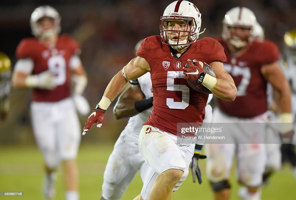 Christian McCaffrey of the Stanford Cardinal's rushes for a twenty eight yard touchdown run against the UCLA Bruins in the second quarter of an NCAA...
