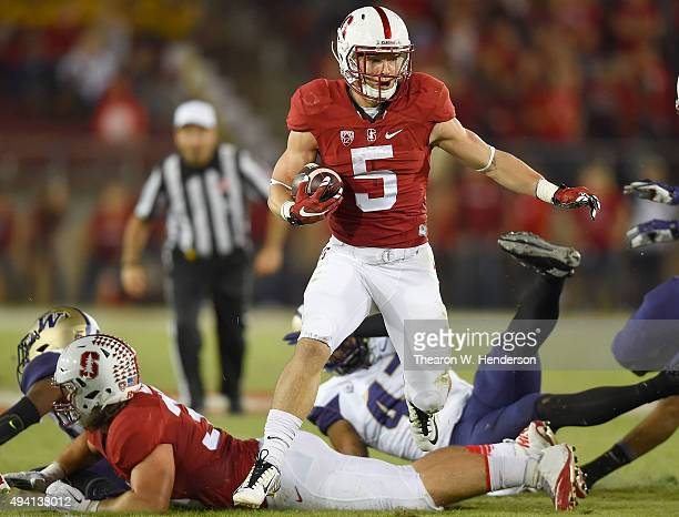 Christian McCaffrey of the Stanford Cardinal's rushes with the ball against the Washington Huskies in the first quarter of an NCAA football game at...
