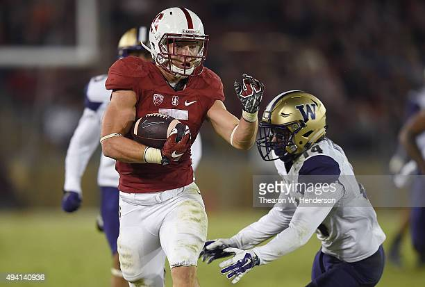 Christian McCaffrey of the Stanford Cardinal's scores a touchdown breaking the tackle of JoJo McIntosh of the Washington Huskies in the third quarter...