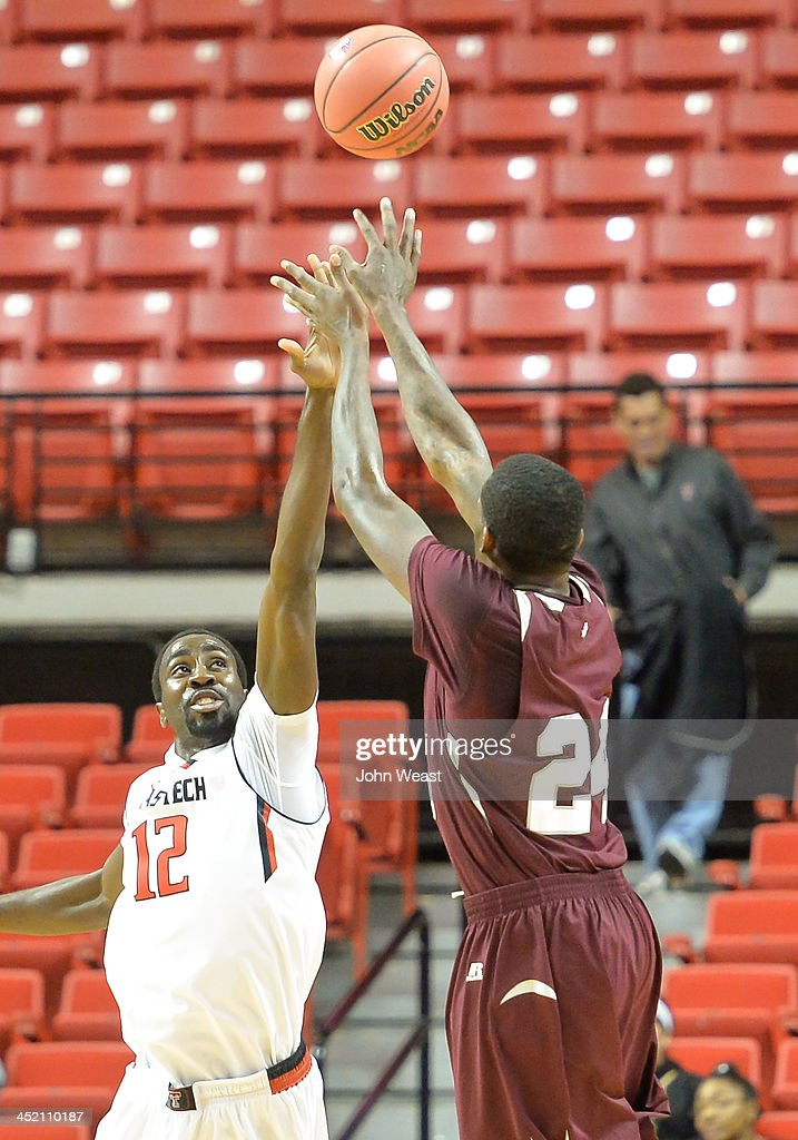 Christian McCoggle #24 of the Texas Southern Tigers shoots the ball over Kader Tapsoba #12 of the Texas Tech Red Raiders during game action on November 18, 2013 at United Spirit Arena in Lubbock, Texas. Texas Tech won the game 80-71.
