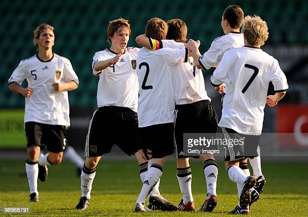 Christian Merz of Germany celebrates with his team mates the goal to 11 during the U16 international friendly match between Denmark and Germany at...