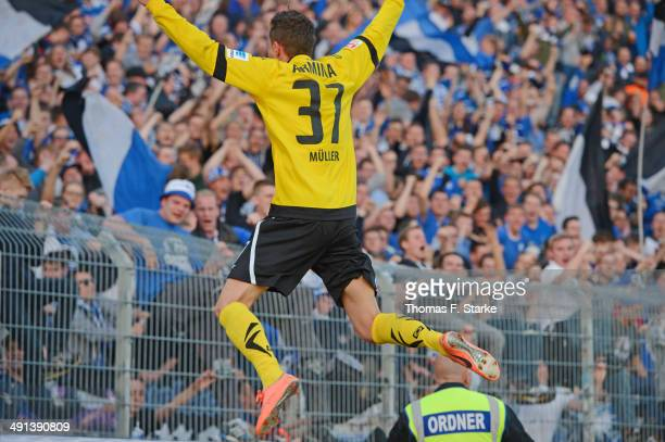 Christian Mueller of Bielefeld celebrates his teams first goal in front of the Bielefeld supporters during the Second Bundesliga Playoff First Leg...