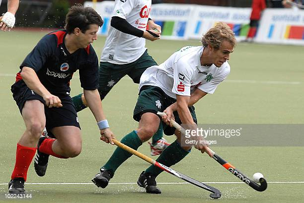 Christian Muenz of Mannheim battles for fhe hockey ball with Jan Ruehr of Muehlheim during the men's 3rd/4th place match between Mannheimer HC and...