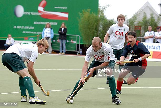 Christian Muenz of Mannheim battles for fhe hockey ball with Thilo Stralkowski of Muehlheim during the men's 3rd/4th place match between Mannheimer...