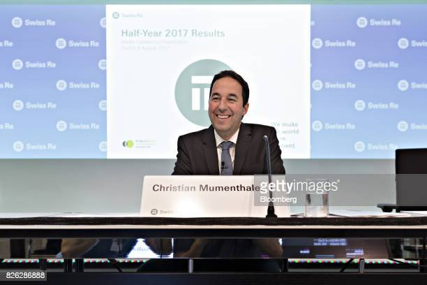 Christian Mumenthaler chief executive officer of Swiss Re AG reacts during a news conference to announce the company's firsthalf results in Zurich...