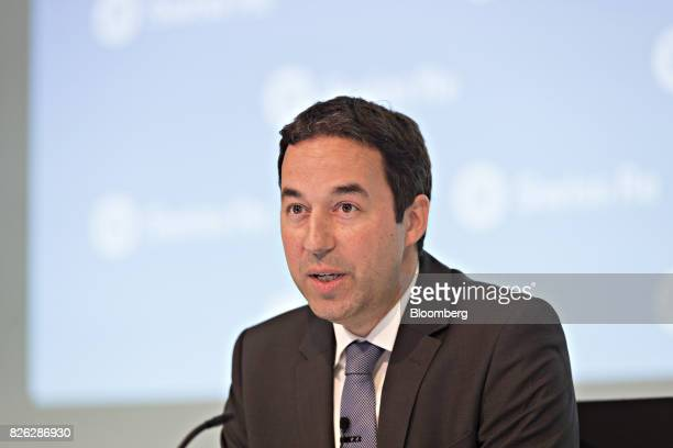 Christian Mumenthaler chief executive officer of Swiss Re AG speaks during a news conference to announce the company's firsthalf results in Zurich...