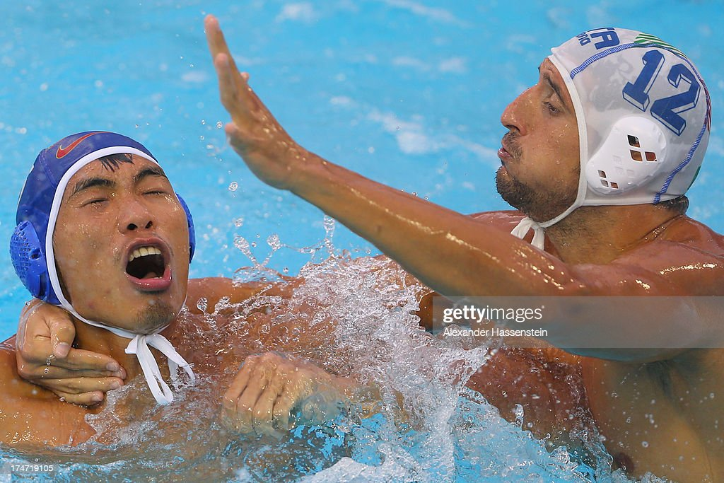 Christian Napolitano (R) of Italy in action with Zhongxing Liang of China during the Men's Water Polo quarterfinals qualification match between Italy and China during day nine of the 15th FINA World Championships at Piscines Bernat Picornell on July 28, 2013 in Barcelona, Spain.