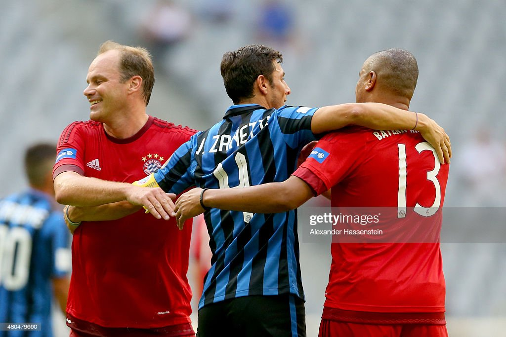 Christian Nerlinger of Bayern Muenchen Allstars and Paulo Sergio shake hands with Javier Zanetti of Mailand after the FC Bayern Allstars against...