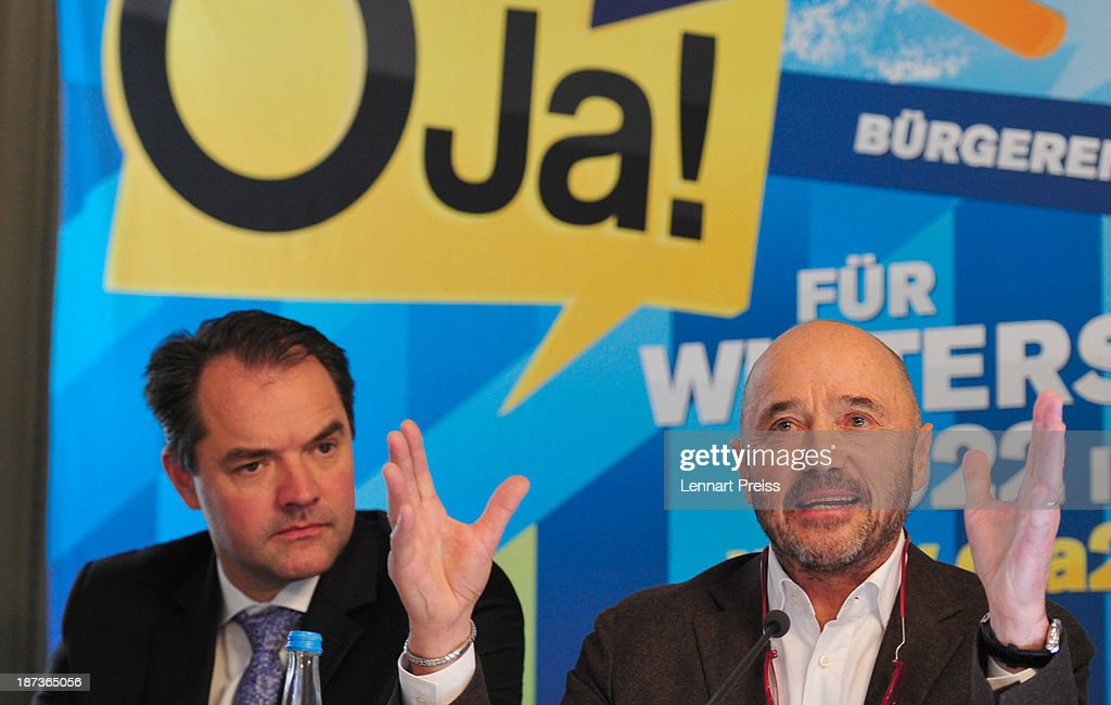 Christian Neureuther, former professional skiier (R) speaks beside Thomas Muderlak, speaker of the Tourism Initiative Munich during a press conference regarding the the city of Munich's application for the Winter Olympic Games 2022 on November 8, 2013 in Munich, Germany.