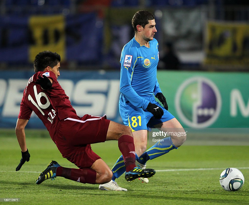 Christian Noboa (L) of FC Rubin Kazan battles for the ball with Razvan Cocis of FC Rostov during the Russian Football League Championship match between FC Rubin Kazan and FC Rostov at the Tsentraliniy Stadium on October 28, 2011 in Kazan, Russia.
