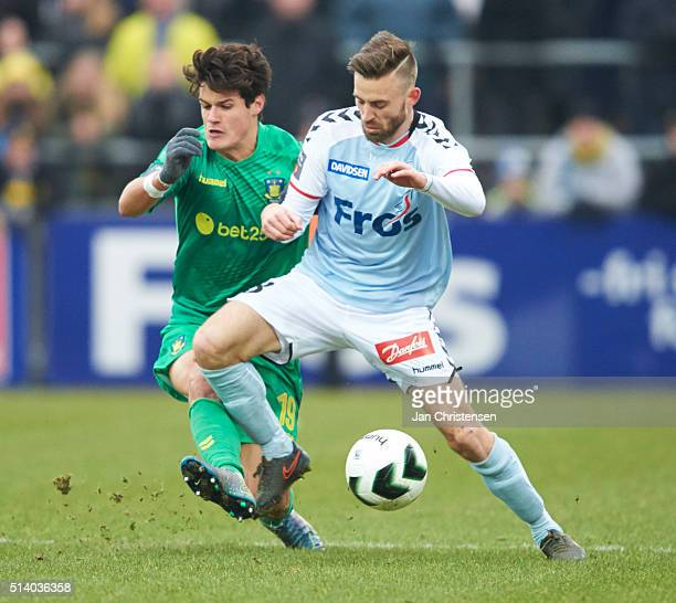 Christian Norgaard of Brondby IF and Janus Drachmann of SonderjyskE compete for the ball during the Danish Alka Superliga match between SonderjyskE...