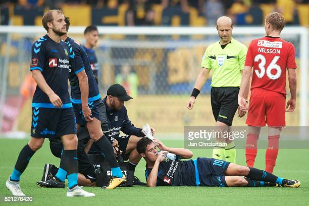 Christian Norgaard of Brondby IF get an injury during the Danish Alka Superliga match between FC Nordsjalland and Brondby IF at Right to Dream Park...