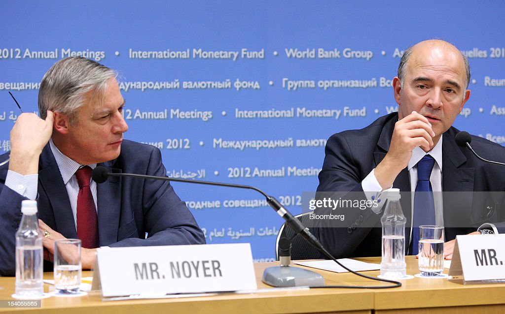 <a gi-track='captionPersonalityLinkClicked' href=/galleries/search?phrase=Christian+Noyer&family=editorial&specificpeople=2257224 ng-click='$event.stopPropagation()'>Christian Noyer</a>, governor of the Bank of France, left, listens as <a gi-track='captionPersonalityLinkClicked' href=/galleries/search?phrase=Pierre+Moscovici&family=editorial&specificpeople=667029 ng-click='$event.stopPropagation()'>Pierre Moscovici</a>, France's finance minister, speaks during a news conference at the Annual Meetings of the IMF and the World Bank Group in Tokyo, Japan, on Saturday, Oct. 13, 2012. The world's finance ministers and central bank governors are gathered in Tokyo for the annual meetings of the IMF and the World Bank as the rebound from the deepest global recession since World War II stagnates. Photographer: Tomohiro Ohsumi/Bloomberg via Getty Images