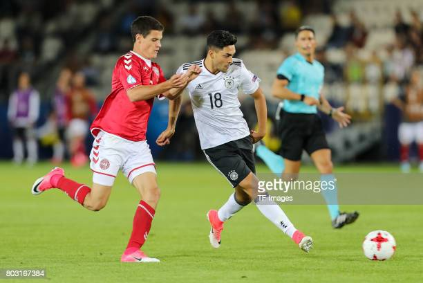 Christian Nrogaard of Denmark and Nadiem Amiri of Germany battle for the ball during the UEFA European Under21 Championship Group C match between...