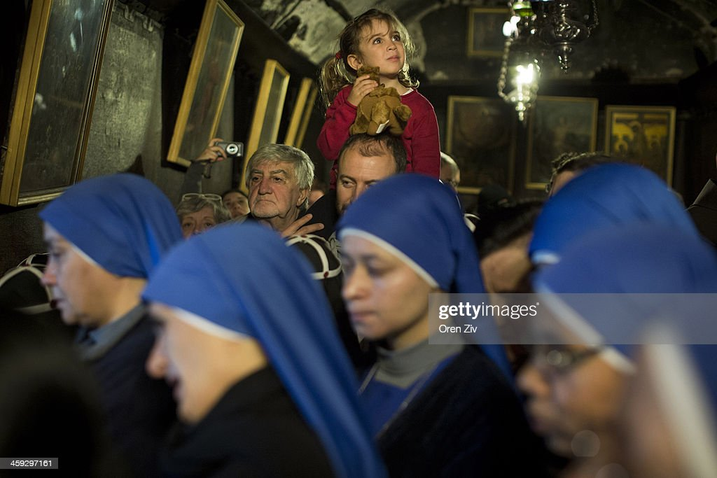 Christian nuns and worshipers pray at the Grotto at the Church of the Nativity, traditionally believed to be the birthplace of Jesus Christ, on December 25, 2013 in Bethlehem, West Bank. Every Christmas pilgrims travel to the church where a gold star embedded in the floor marks the spot where Jesus was believed to have been born.