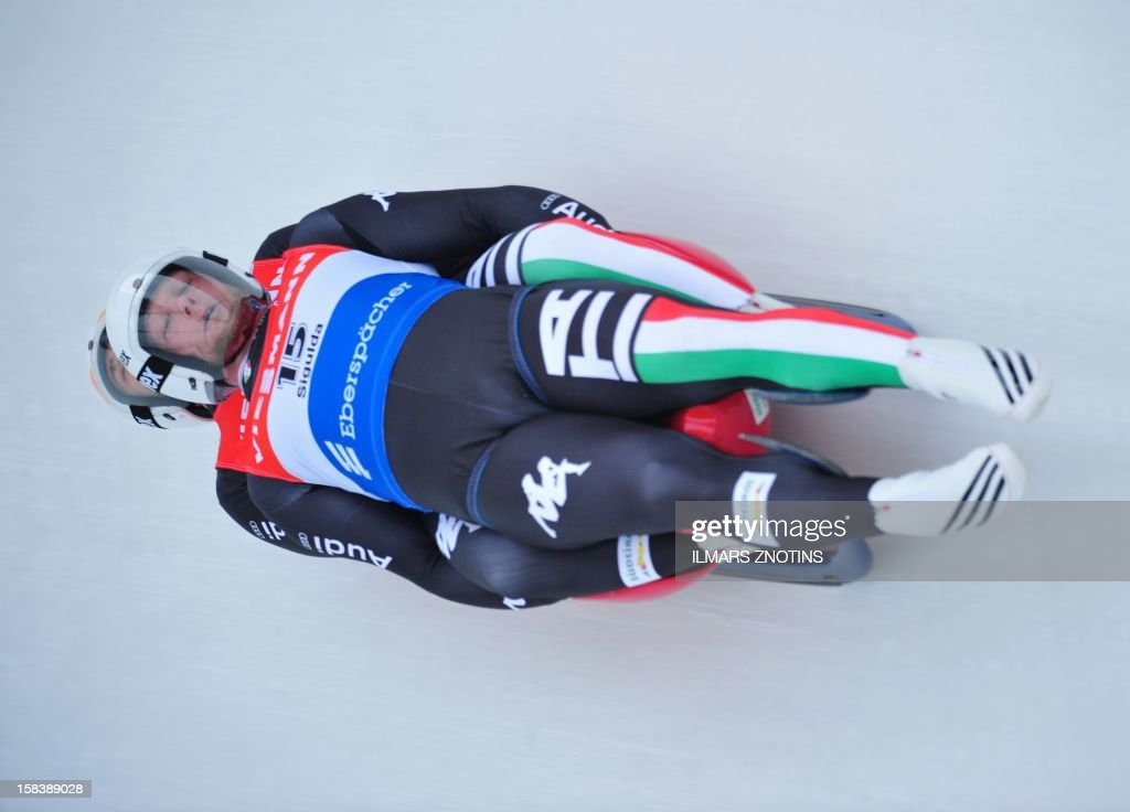 Christian Oberstolz and Patrick Gruber of Italy take a run at Luge World Cup Doubles competition on December 15 , 2012 in Sigulda, Latvia, some 50 km northeast of Riga. The pair finished in third place.