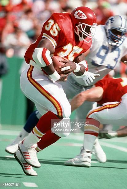 Christian Okoye of the Kansas City Chiefs carries the ball against the Detroit Lions during an NFL football game October 14 1990 at Arrowhead Stadium...