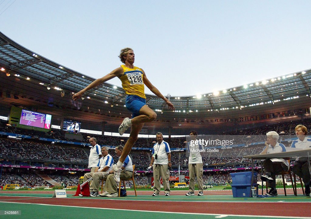 Christian Olsson of Sweden flies through the air during the men's triple jump final at the 9th IAAF World Athletics Championship August 25, 2003 in Paris.