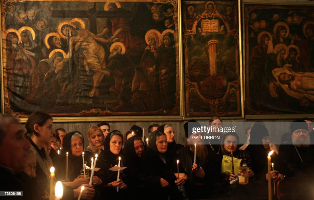 Christian Orthodox pilgrims attend a special Easter prayer at the Church of the Holy Sepulchre in Jerusalem's Old City, 04 April 2007. According to the Christian tradition the church is built on the site where Jesus was crucified and buried. Christian believers around the world mark the Holy Week of Easter in celebration of the crucifixion and resurrection of Jesus Christ.