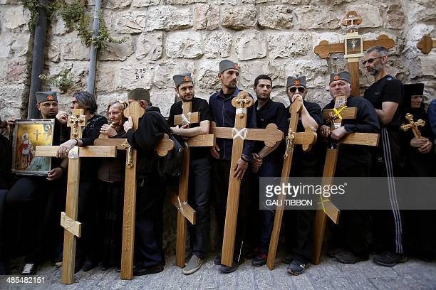 Christian Orthodox pilgrims carry wooden crosses during the Good Friday procession along the Via Dolorosa on April 18 2014 in Jerusalem's Old City...