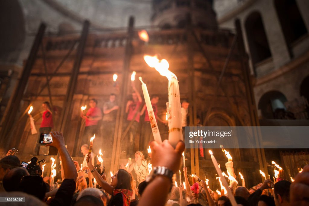 Christian Orthodox worshipers hold candles lit from a flame that emerged from the tomb believed to be of Jesus Christ as they take part in the ceremony of the holy fire at the Church of the Holy Sepulcher April 19, 2014 in Jerusalem, Israel. The ancient fire ritual celebrates the Messiah's resurrection after being crucified on the cross.