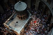Christian Orthodox worshippers dance and pray around the Tomb of Jesus as thousands gather in the Church of the Holy Sepulchre in Jerusalem's Old...