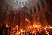 Christian Orthodox worshippers hold candles lit from the 'Holy Fire' as thousands gather in the Church of the Holy Sepulchre in Jerusalem's Old City...