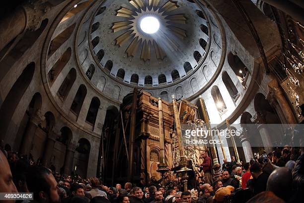 Christian Orthodox worshippers parade around Jesus' tomb ahead of lighting candles from the Holy Fire in the Church of the Holy Sepulchre in...