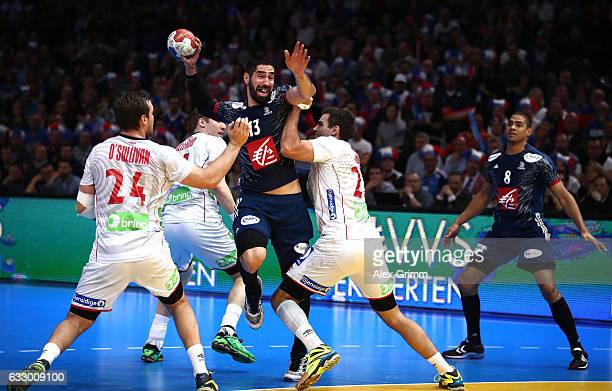 Christian O'Sullivan of Norway and Eivind Tangen of Norway tackle Nikola Karabatic of France during the 25th IHF Men's World Championship 2017 Final...