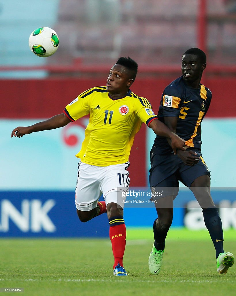 Christian Palomeque (L) of Colombia and Jason Geria of Australia compete for the ball during the FIFA U-20 World Cup Group C match between Colombia and Australia at Huseyin Avni Aker Stadium on June 22, 2013 in Trabzon, Turkey.