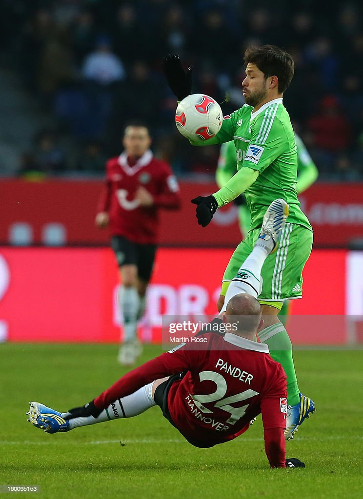 Christian Pander (#24) of Hannover and Diego (back) of Wolfsburg battle for the ball during the Bundesliga match between Hannover 96 and VfL Wolfsburg at AWD Arena on January 26, 2013 in Hannover, Germany.