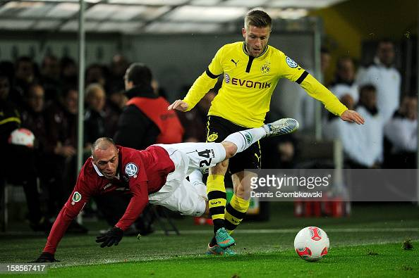 Christian Pander of Hannover and Jakub Blaszczykowski of Dortmund battle for the ball during the DFB Cup match between Borussia Dortmund and Hannover...